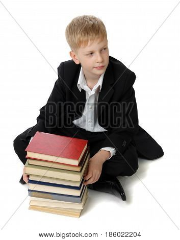 Schoolboy with the books. View from above.