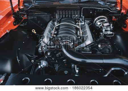 Under the hood of sports car. Powerful engine closeup. Clean motor block.