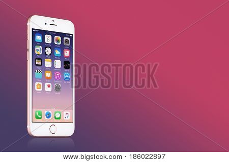 Varna, Bulgaria - March 10, 2016: Rose Gold Apple iPhone 7 with iOS 10 on the screen on pink gradient background with copy space. Quick mockup for your design. High quality studio shot.