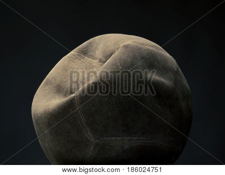Old vintage volley ball on a dark background