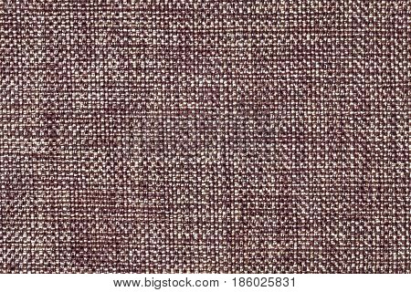 Brown and white background with wicker pattern closeup. Structure of the umber fabric with natural texture. Cloth backdrop.