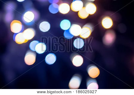 Christmas Background. Festive Abstract Holidays Background With Bokeh Defocused Lights And Stars.