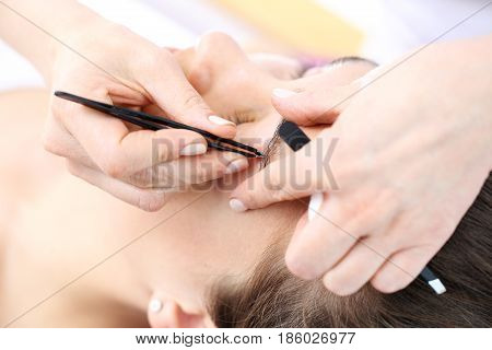 Hair removal. Adjusting the eyebrows in the beauty salon. Henna and eyebrow adjustment. Eyebrow styling