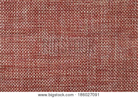 Dark red background with checkered pattern closeup. Structure of the brown fabric with natural texture. Cloth backdrop.