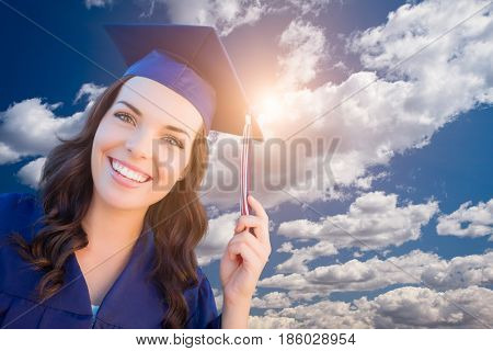 Happy Graduating Mixed Race Woman In Cap and Gown.