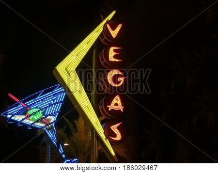 Las Vegas, USA - August 15, 2008; Neon sign in Fremont Downtown district Las Vegas against dark background.