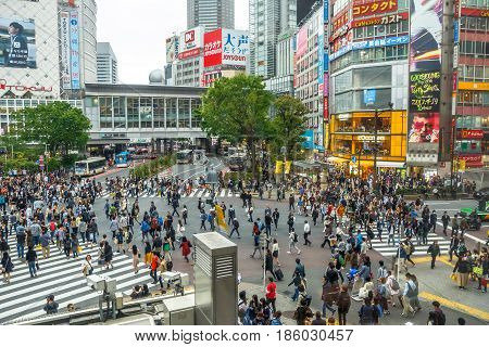 Tokyo, Japan - April 22, 2017: aerial view from Starbucks in front of Shibuya Station and L'Occitane Cafe, of popular Shibuya Crossing, one of the busiest crosswalks in the world.