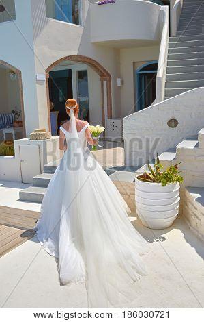 SANTORINI, GREECE - AUGUST 05, 2015: Beautiful young bride in Andromeda Villas hotel. Andromeda Villas is a hotel are situated in Imerovigli, Santorini island.
