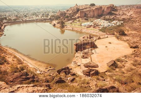 Indian landscape with water pond and ancient town Badami of Karnataka.
