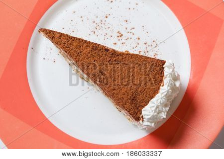 A Piece Of Tiramisu Topping With Cocoa Powder