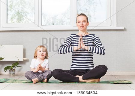 Hatha Yoga Fitness Mother With Baby.