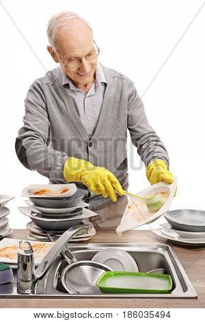 Elderly man doing the dishes isolated on white background
