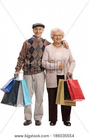 Full length portrait of seniors with shopping bags looking at the camera and smiling isolated on white background