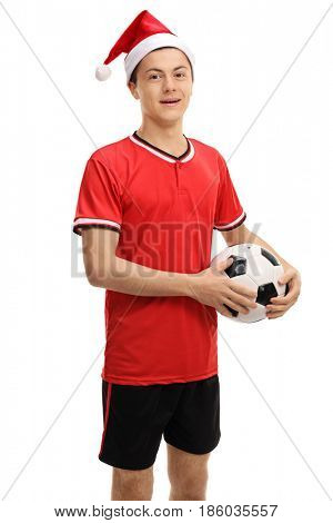 Teenage soccer player with a Christmas hat isolated on white background