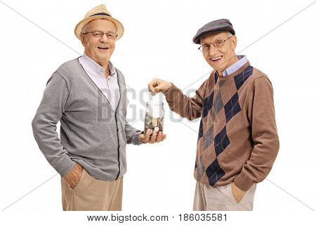 Elderly man holding a money jar with another elderly man putting a coin in it isolated on white background