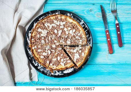 Homemade cheesecake - healthy organic summer dessert pie cheesecake. Cheese cake on blue wood table. Top view