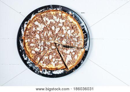 Homemade cut cheesecake - healthy organic summer dessert pie cheesecake. Cheese cake on white wood table. Top view