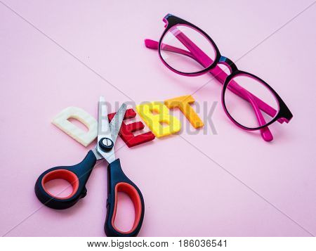 cut dept concept with text pink glasses and scissor