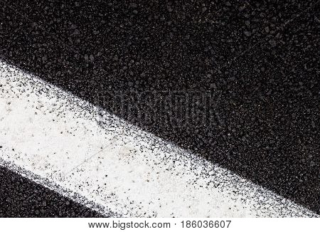 Tarmac background and texture. White line on road.