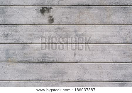 closeup of grey concrete wall with lineal parts horizontal lines