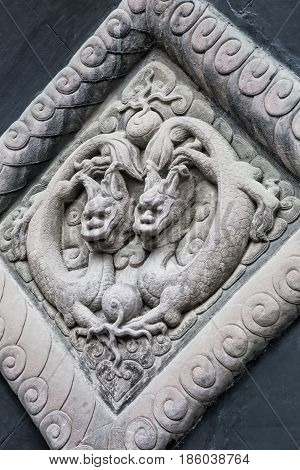 Dragon sculptures showing details in the Wuhoe Shrine in Chengdu sichuan province China
