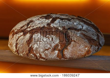Loaf Of Fresh Black Rye Bread Out Of Oven Close Up