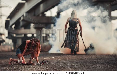 Battle of two mutants. Mutant with hammer goes to girl mutant through smoke.