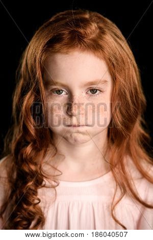 Portrait Of Adorable Offended Redhead Girl Looking At Camera Isolated On Black