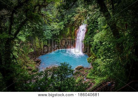 Top view long exposure of celestial blue waterfall in volcan tenorio national park, Costa Rica