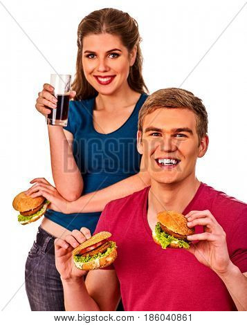 Couple eating fast food. Man and woman treat big hamburger with ham. Friends give burder junk on white background isolated. Food semi-finished products.