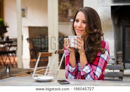 Beautiful woman drinking coffee at cafe