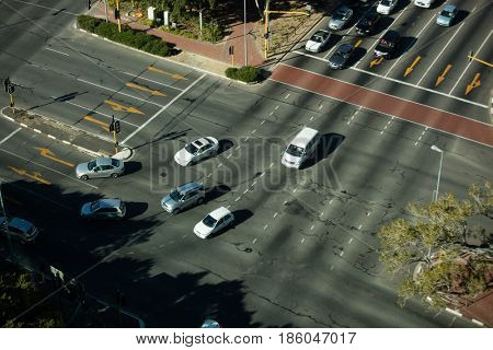 High angle view of road intersection in city on sunny day