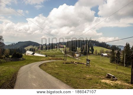 The path runs along the mountain ridges in the Beskydy in the Czech republic. Sky and clouds rays of the sun.
