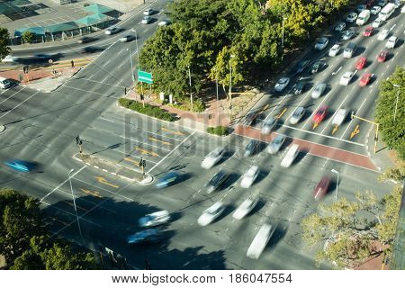 High angle view of cars moving on road in city
