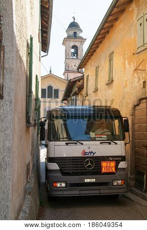 Gas Truck On Narrow Streets At Castelrotto On Switzerland