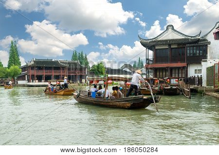 China traditional tourist boats on canals of Shanghai Zhujiajiao Water Town in Shanghai China