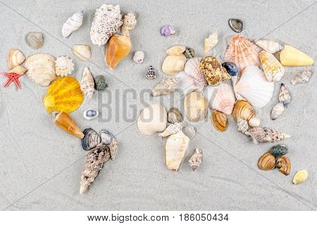Map Of The World Made Of Shells On Sand