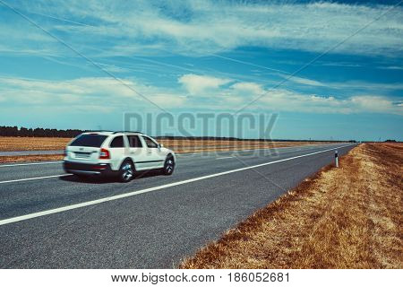 Car travel on europe road. Blue sky and summer field panorama.
