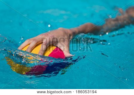 Close-up On A Hand Holding The Water Polo Ball During The Greek League Water Polo Game Paok Vs Glifa