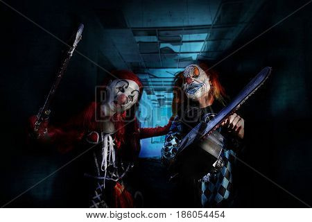 scary clowns in horror mad house on Halloween