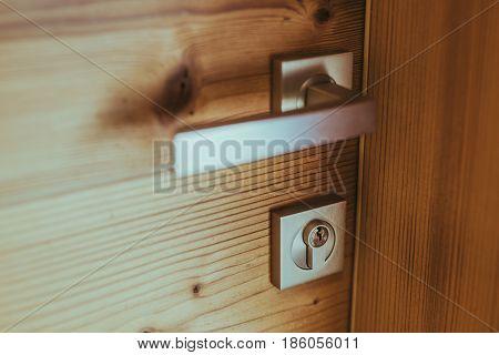 Modern wooden door and handle with lock
