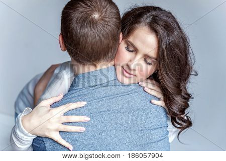 Young couple in love. Couple supporting each other and relying on each other having nice time together. Young happy woman hugging her handsome boyfriend. Portrait of cheerful casual people in love, students having hopes, dreams, goals, bride and groom wit