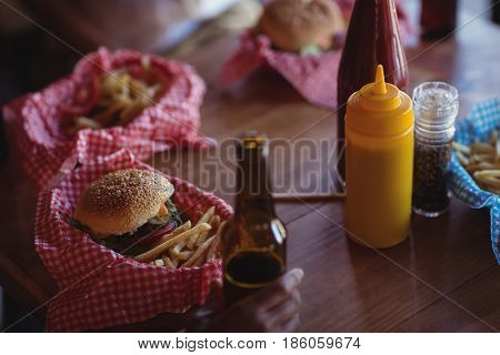 Fast food and beer bottle on table in restaurant