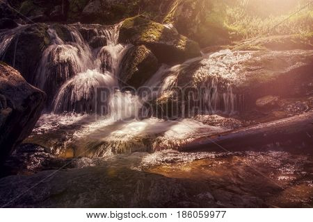 Long exposure at a little waterfall with sun