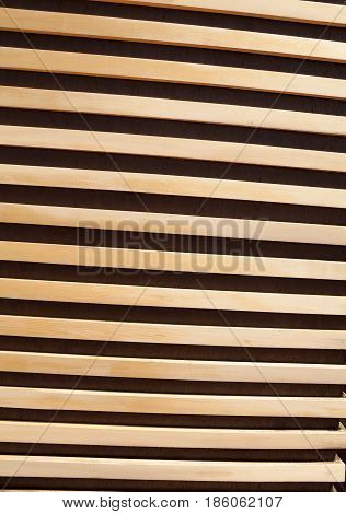Wooden planks striped wall close-up textured background. Dark and light diagonal lines whitewood contrasting pattern