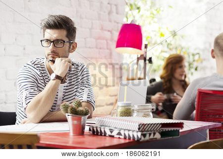 Hipster Student Working In Industrial Cafe