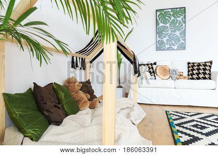 Botanical calm bright kids interior with tropical prints
