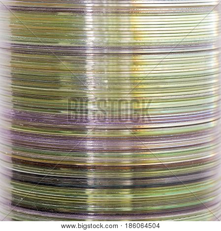 Stack of old compact discs, abstract close-up background