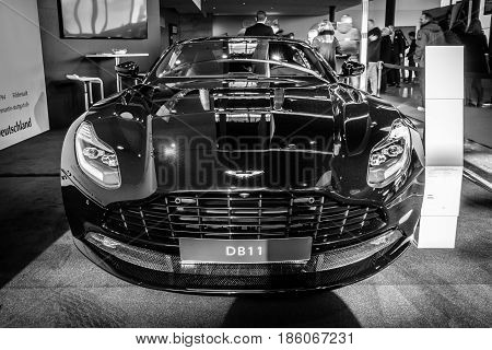 STUTTGART GERMANY - MARCH 02 2017: Grand tourer car Aston Martin DB11 2016. Black and white. Europe's greatest classic car exhibition