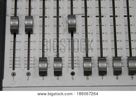 Professional Audio Operator Working On Audio Mixer Knobs During Live Tv Telecast